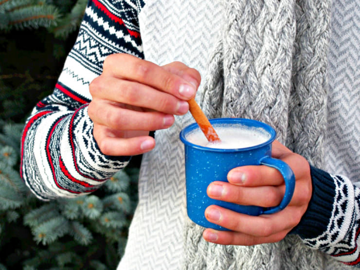 Hot-Buttered-Rum is a delightful holiday cocktail made with sweetened butter, hot frothed milk, warm spices, and a splash of spirits (adults only) or rum extract (for all ages).