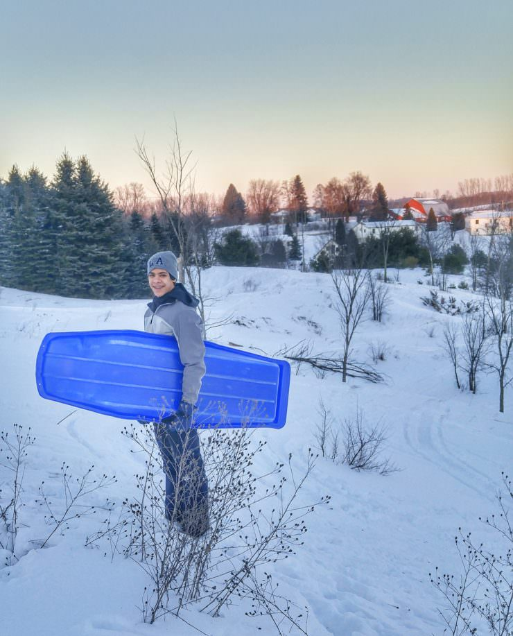 Son-#1-sleds-at-sunset