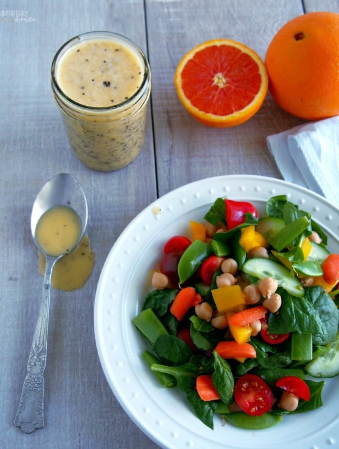 Chopped-Salad-with-Orange-Poppy-Seed-Dressing combines the season's best vegetables and dresses them in sweet and tangy citrus vinaigrette with added crunch.