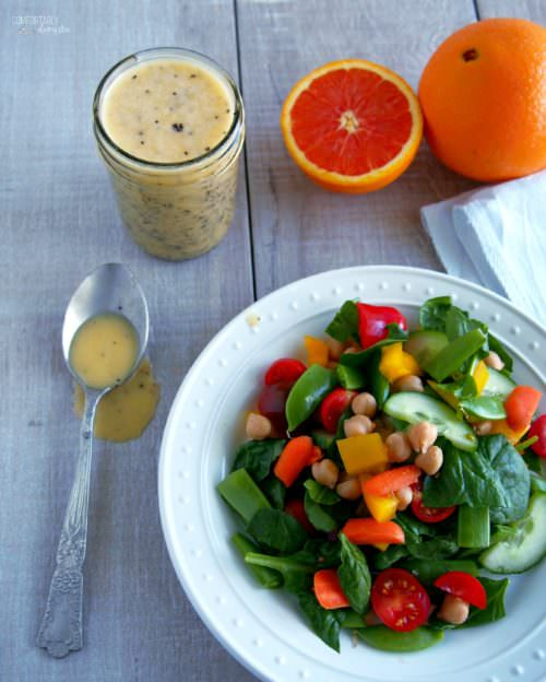 Chopped-Salad-with-Orange-Poppy-Seed-Dressing is a bed of fresh, crunchy vegetables topped with homemade tangy-sweet orange poppy seed dressing is the perfect salad of summer.