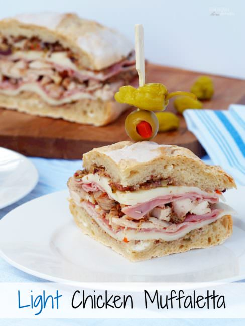 Light-Chicken-Muffaletta-Sandwich takes a healthier spin with tender chicken, smoked ham, provolone, and the classic olive salad sandwiched between soft and crusty bread.